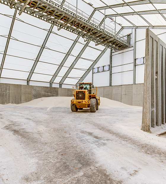 fabric structure with conveyor and precast walls